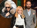 LONDON, ENGLAND - DECEMBER 07:  Kylie Minogue (L) and Joshua Sasse attend an intimate performance with Kylie Minogue at The Ivy to kick off The Ivy 100 Centenary celebrations on December 7, 2016 in London, England.  \nPic Credit: Dave Benett