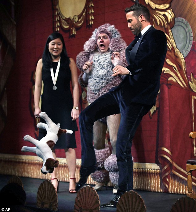 Poor puppy: In another skit, the Golden Globe nominee kicked a stuffed dog off the stage