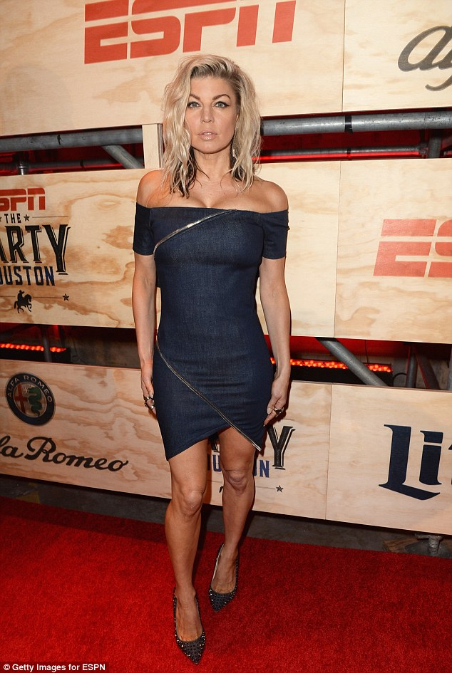 She has great jeans! Fergiewas dressed to kill in a skin tight jean dress that hugged her cleavage and toned legsat the 13th annual ESPN The Party in Houston, Texas on Friday