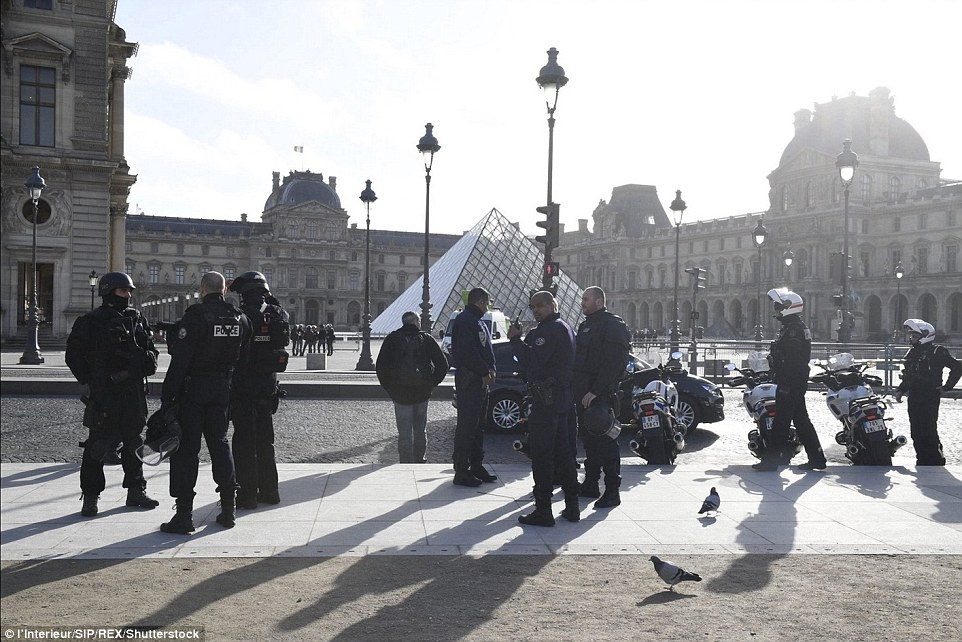 Large teams of police officers descended on the iconic Louvre museum following this morning's shooting