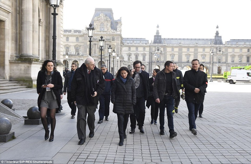 Mayor of Paris Anne Hidalgo (centre) praised the 'extreme efficiency' of soldiers who foiled this morning's attack