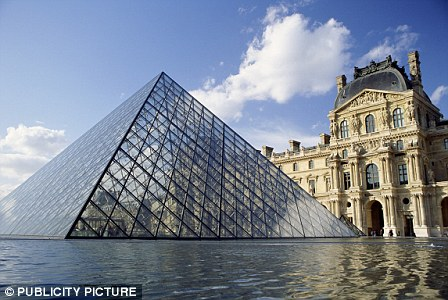 The distinctive pyramid was completed in 1989, and the inverted pyramid beneath it in 1993