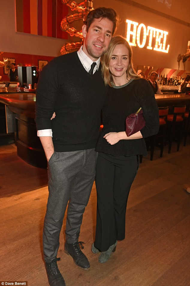 Picture perfect: Arriving at the Ham Yard hotel in Soho, the 37-year-old actor was all smiles as he cosied up to his wife, Emily,33