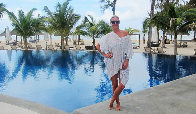 Denise van Outen is pictured by the pool in Mauritius