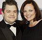 FILE - In this Jan. 12, 2012 file photo, Patton Oswalt, left, and his wife Michelle Eileen McNamara arrive at the 17th Annual Critics' Choice Movie Awards in Los Angeles. Oswalt says coroner¿s officials have told him that his wife died last year from a combination of prescription medications and an undiagnosed heart condition. His statement, released by a publicist, says coroner¿s officials have informed him that the blockages, combined with her taking the medications Adderall, Xanax and the pain medication fentanyl, caused his wife¿s death in April 2016. McNamara died April 21 in her sleep at age 46. (AP Photo/Matt Sayles, File)