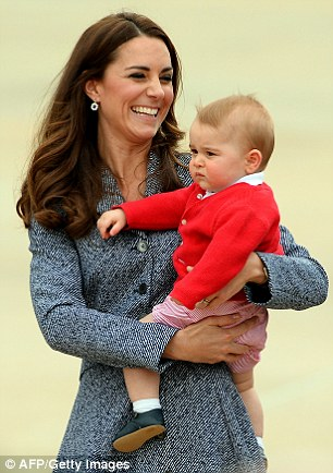 George is cuddled by his mother, the Duchess of Cambridge