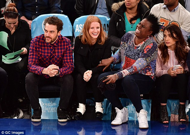 All smiles: The group couldn't control their laughter as they settled down courtside