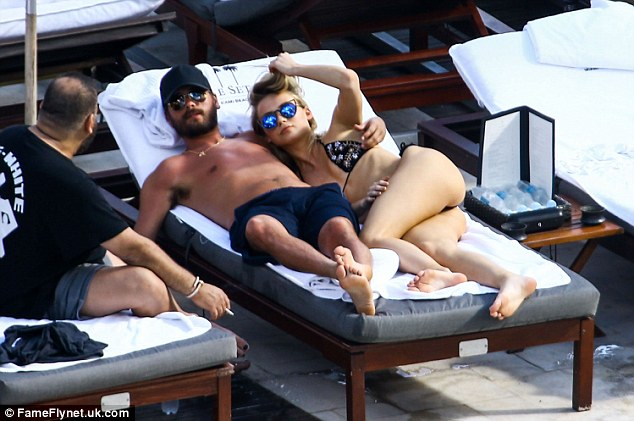 Getting close:Lately, however, Scott has been pictured partying and cuddling with a couple of beauties in Miami