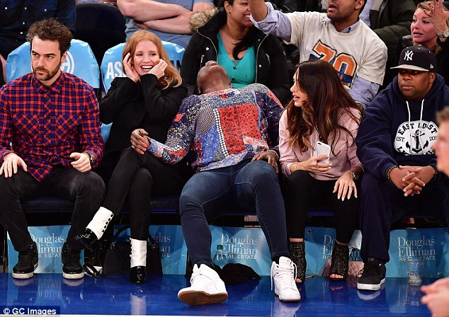 Loving life: The radiant redhead was very expressive as she watched the game, gasping and cheering from courtside, whilst Leslie laughed away beside Keenan Thompson