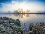 A beautiful sunrise over the River Great Ouse near Ely in Cambridgeshire on a frosty Monday morning today