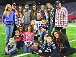Patriots quarterback Tom Brady shared a family photo following Sunday's Super Bowl win, captioning it 'It takes a team. And so much love'. The photo features in the back row from left Brady's sister Julie, father Tom Brady Sr, sister Maureen, brother-in-law Steve Bonelli (Nancy's husband), sister Nancy, mother Galynn, wife Gisele Bundchen and brother-in-law Kevin Youkilis (Julie's husband). Center, in Brady's arms are daughter Vivian (left) and nephew Jeremy. In the front row, from left are nephew Zachary, another nephew, nieces Hannah and Jordan, sons Benjamin and Jack, and niece Maya