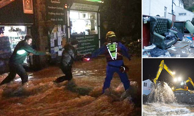 Dramatic moment residents in flooded village form a HUMAN CHAIN to rescue people trapped