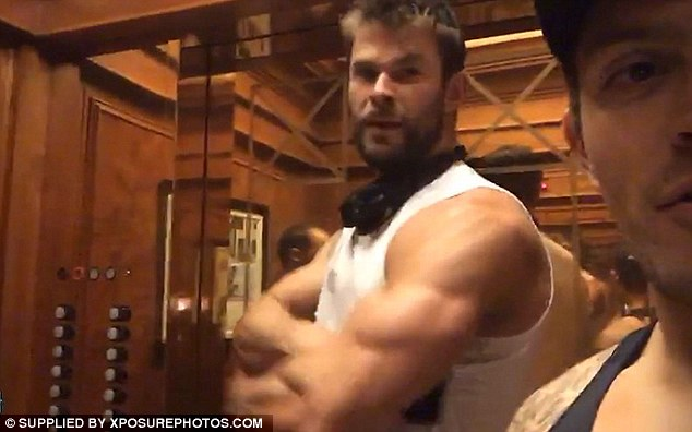Bulging biceps: He enters the lift looking suspiciously at the fan taking a selfie and quickly strikes a pose