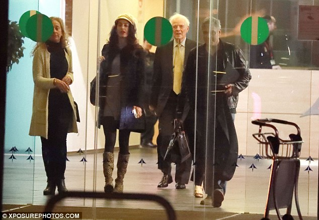 Family time: Amal and George looked in good spirits as they arrived in the Spanish city with the actor's parents