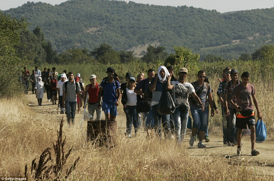 Immigrants cross the Macedonian border and head towards Gevgelia from where they will be transported into Serbia