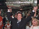 FILE - In this June 17. 1998, file photo, Detroit Red Wings owner Mike Ilitch, center, hoists the Stanley Cup in Washington after the Red Wings won their second consecutive NHL championship. Igor Larionov is at left. Ilitch, founder of the Little Caesars Pizza empire and owner of the Red Wings and the Detroit Tigers, has died. He was 87. Ilitch, who was praised for keeping his professional hockey and baseball teams in Detroit as other urban sports franchises relocated to new suburban stadiums, died Friday, Feb. 10, 2017, at a hospital in Detroit, according to family spokesman Doug Kuiper. (Julian H. Gonzalez/Detroit Free Press via AP)