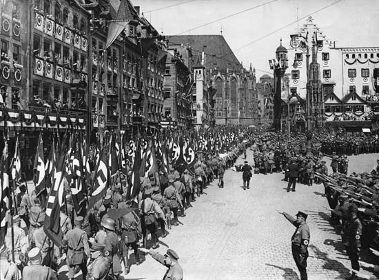 Nazi Storm Troopers marching through the streets of Nürnberg, Germany, after a Nazi Party rally.