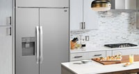 Pacific Kitchen & Home. Designer kitchen with refrigerator and other appliances.