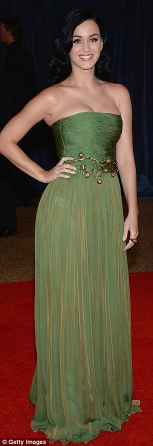 All grown up: Pop star Katy Perry looked elegant in a floor-length green strapless gown that she accessorised with an unusual gold belt around her waist