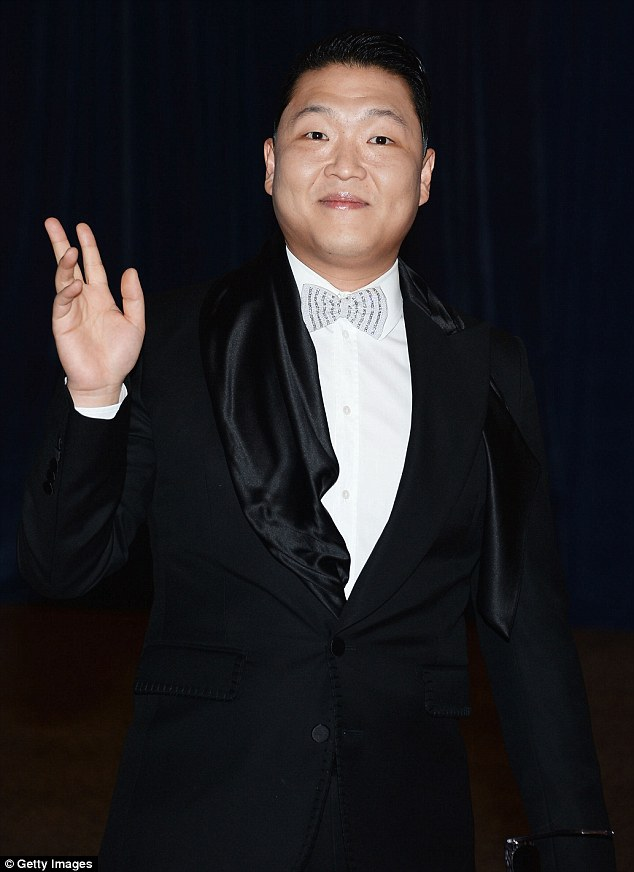 Gangham style: South Korean rapper Psy wore a quirky striped bowtie as he waved to photographers