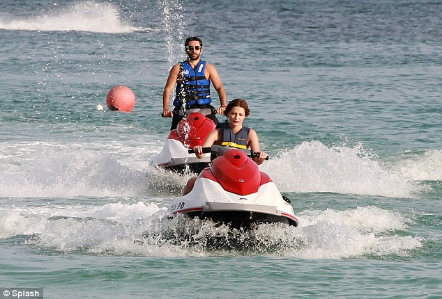 Action girl: The actress enjoyed a spot of water sports on a red and white jet ski