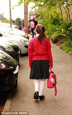 Pictured, an Eastern student sporting the school uniform's red jumper