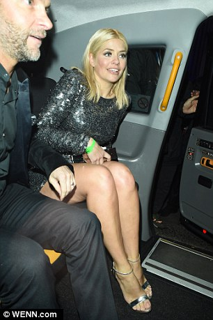 Holly party hopped around the Warner and Universal bashes across London with her equally as jolly husband Daniel Baldwin