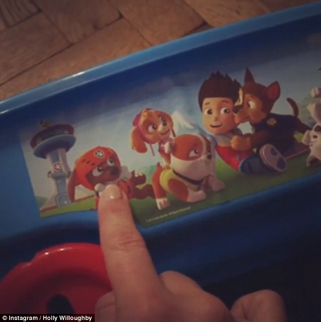 Sweet: The mum-of-three gave a rare insight into her family life - which she often keeps under wraps - with the cute clip which she captioned: 'Paw Patrol obsessed! #chester #adorbs #pawpatrol'