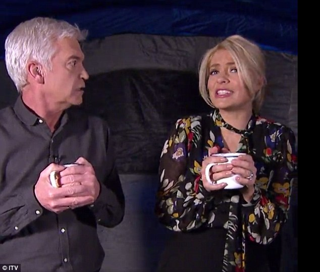 Acting up: The TV presenter (right) was helping to present a segment on camping with Philip Schofield (left)
