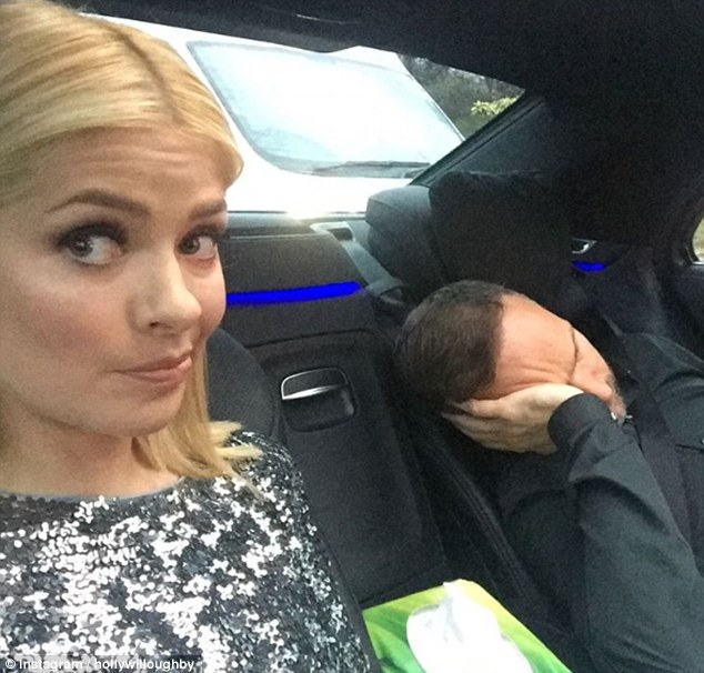 Snooze fest: Clearly with some time on her hands, the glamorous mother-of-three also shared a picture of herself and her husband Dan Baldwin who had fallen asleep in the car