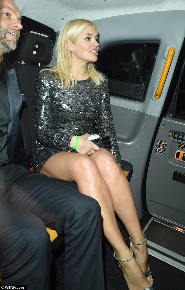 Thirsty work! No wonder she needed a drink at the bash - she had been stuck in traffic in a tunnel as she headed to the awards show at the 02 London Arena