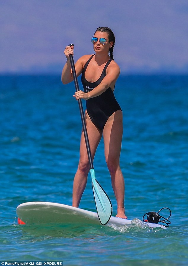 Stunning: Michelelooked in fantastic shape as she participated in some paddleboard yoga in Maui, Hawaii on Wednesday