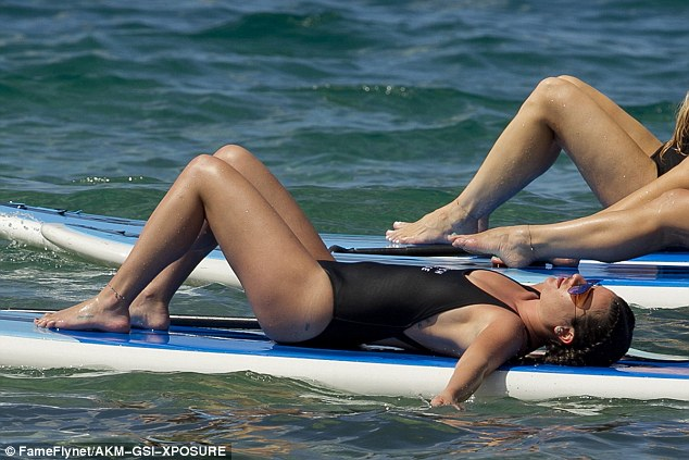 Time to relax: She was later seen getting into shavasana