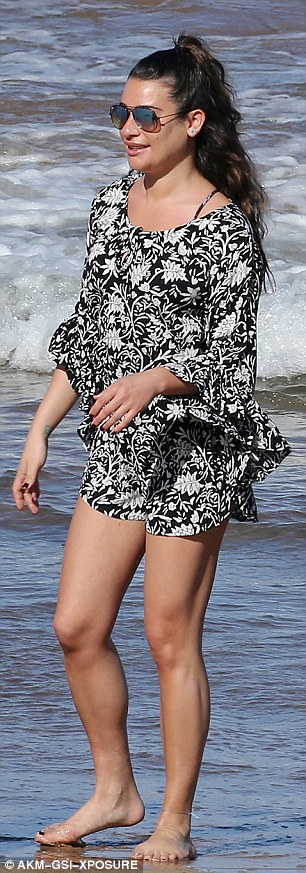 Looking good: The beachwear was black and white with a leaf patterned design