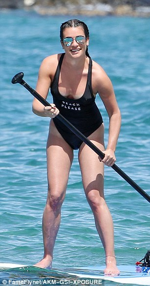 Rowed over: Lea paddled further into the water before continuing the yoga session