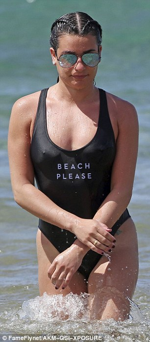 'Beach please': Her swimwear featured a cheeky saying on it
