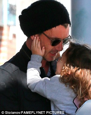 Shaded: At one point the hunky British musician wore a black beanie cap and kept concealed behind dark sunglasses