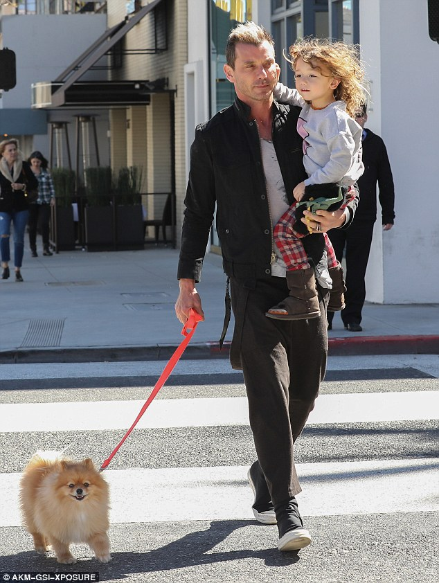 Puppy love! The father and son duo were joined by their family Pomeranian for the afternoon outing