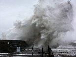 Britain is bracing for a cold snap that could see parts of the country hit with snow in March - just days after Storm Doris wreaked havoc across the country. Pictured is stormy weather in Harrington, West Cumbria, earlier today