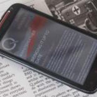 Mobile phone on old-style newspaper
