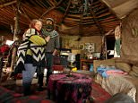 Kate Burrows, 45, and her partner Alan, 47 built their house from tree trunks, mud and straw, in the Tarka Valley, near Chulmleigh, Devon, pictured