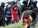 Indonesian suspect Siti Aisyah, center, is escorted by police officers as she arrives at Sepang court in Sepang, Malaysia on Wednesday