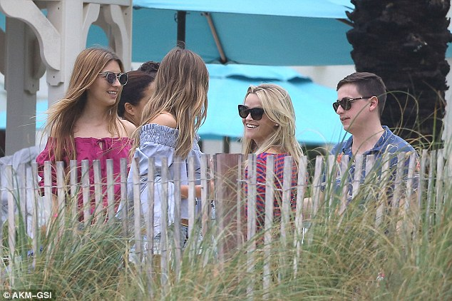 Happiness: The starlet was seen smiling at other attendees during the outdoor get-together
