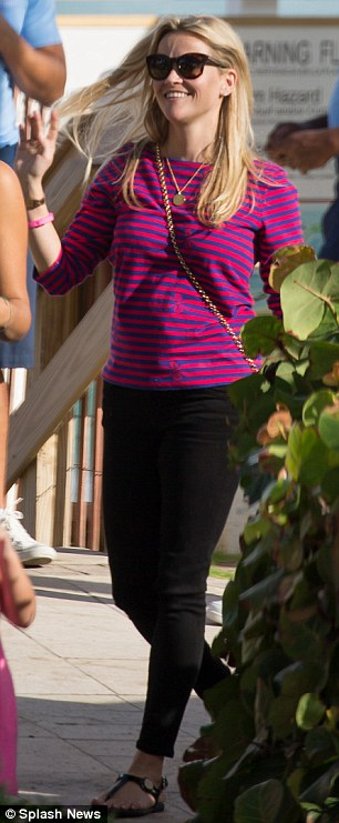 On the go: The actress wore a fuchsia and blue striped top with jeans and sandals for the Sunday lunch