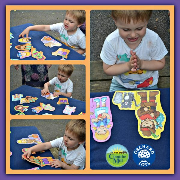Child at Coombe Mill Holidays completing Orchard Toys first jigsaw.jpg