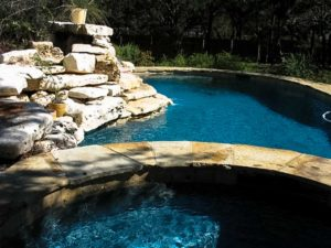 Freeform PoolThis freeform pool has a water feature and elevated spa...