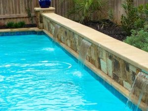Sheer Descent Water FeaturesThree sheer descent water features decorate this lap pool...