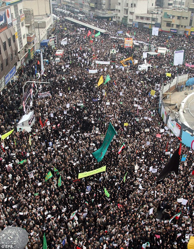 The crowd waved large banners and flags showing their support for the regime today