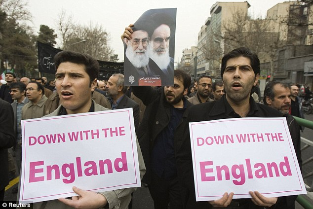 Anti-Western: Government supporters protest against opposition demonstrations in Tehran today