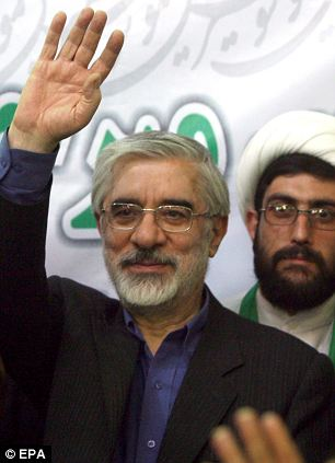 Hate figure: Hossein Mousavi pictured waving to his supporters at a rally in Islamshahr in May